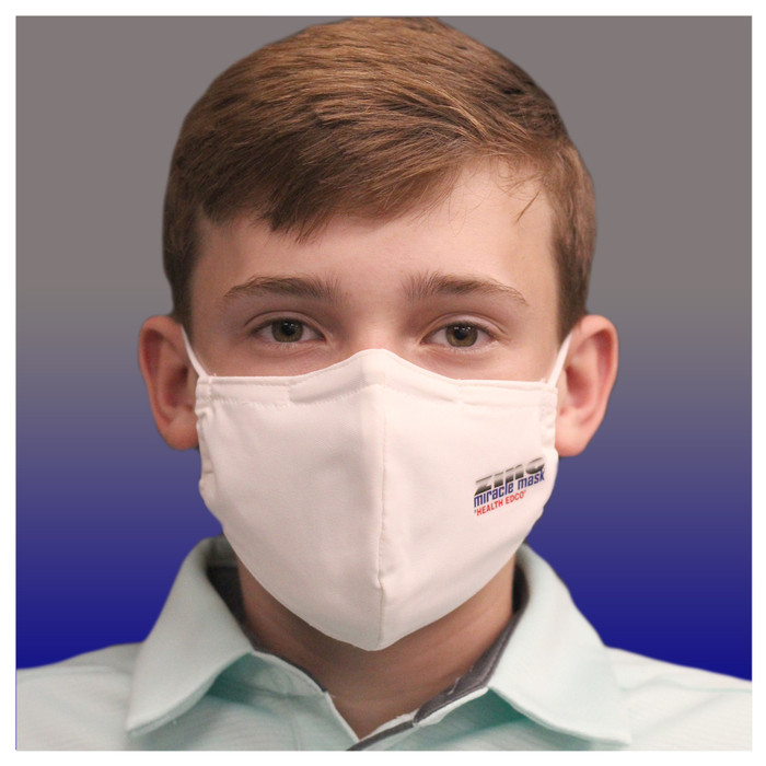 Zinc Miracle Mask by Health Edco, front view of teen boy in one-size-fits-most white cloth face mask of durable fabric, 78866