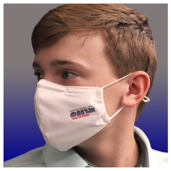 Zinc Miracle Mask by Health Edco, side view of teen boy in one-size-fits-most white cloth face mask of durable fabric, 78866