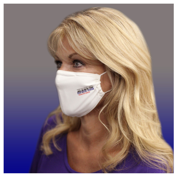Zinc Miracle Mask by Health Edco, side view of woman wearing one-size-fits-most durable white cloth fabric face mask, 78866