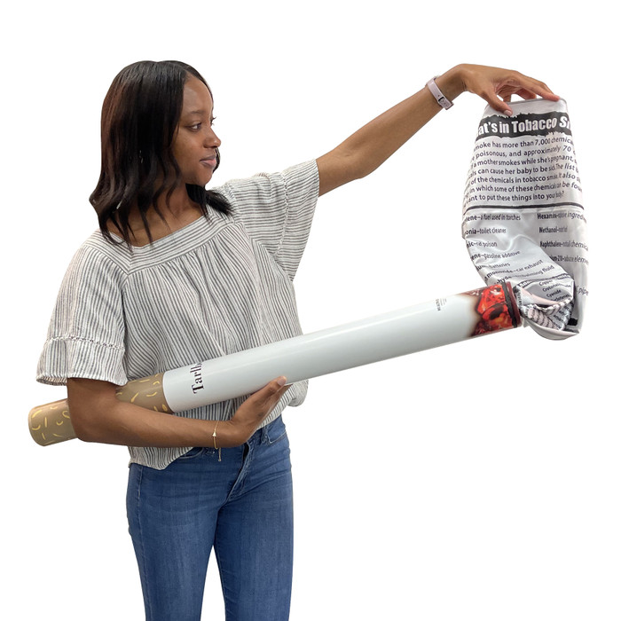 Boy holding Health Edco's Giant Cigarette Model and pulling out educational banner about dangers of tobacco smoke, 79110
