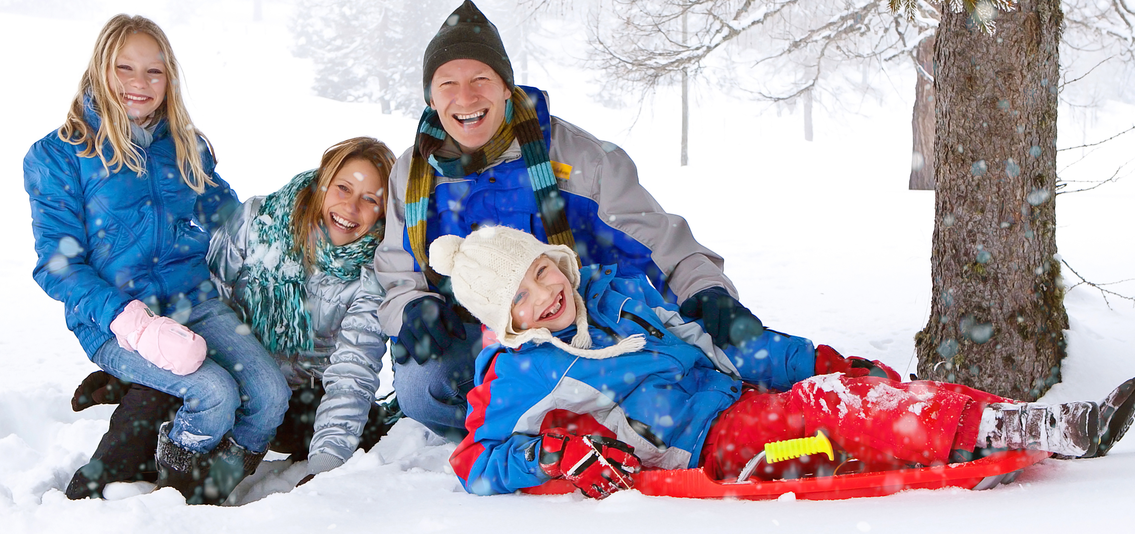 Happy family playing in the snow