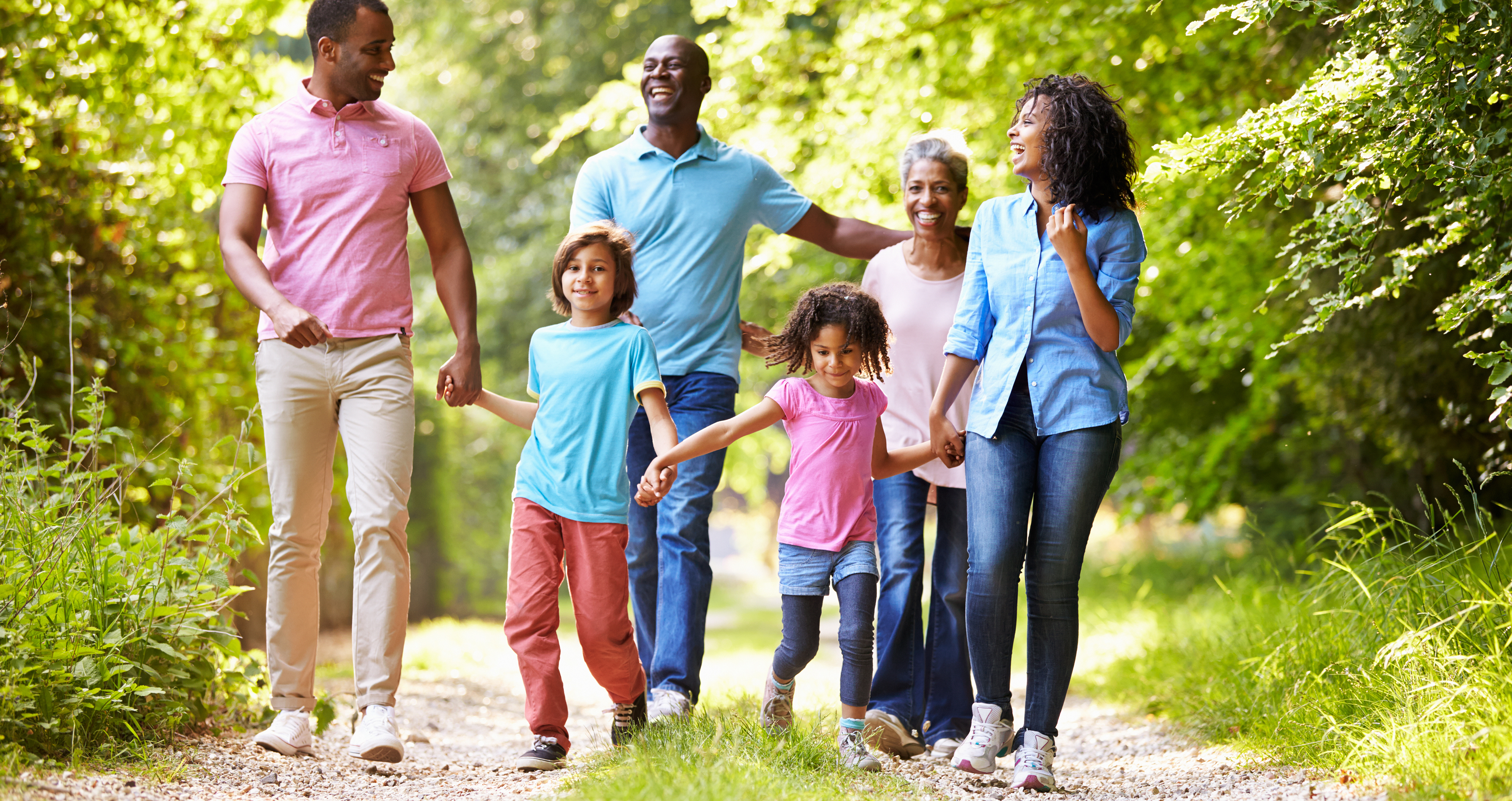 Multiple generations of a family enjoying a walk for physical activity
