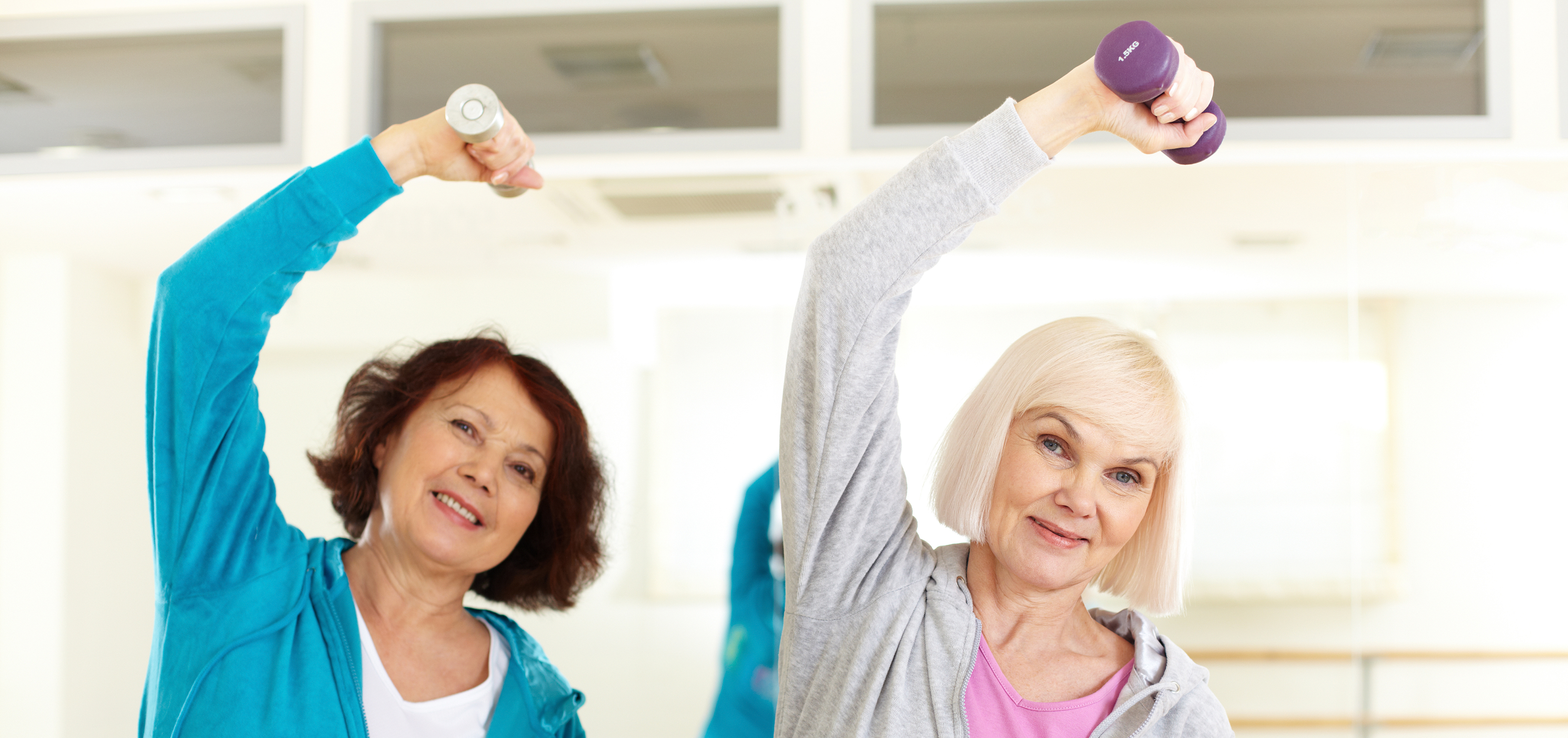 Older women exercising with hand weights